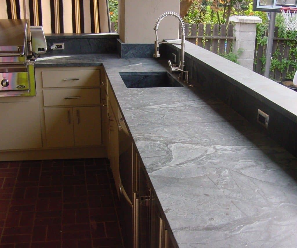 The Best Guide to Soapstone Countertops - Remodel Or Move Natural Soapstone Countertops on recycled glass countertop, granite countertop, lava stone countertop, bluestone countertop, natural kitchen countertops, natural bamboo countertop, natural quartz countertop, natural limestone countertop, plastic laminate countertop, natural stone countertop, natural butcher block countertop, natural agate countertop, natural concrete countertop,