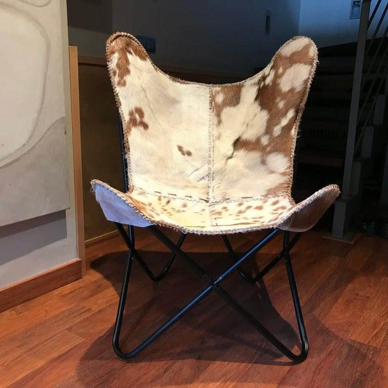 A BUTTERFLY CHAIR WITH REAL GOAT FUR