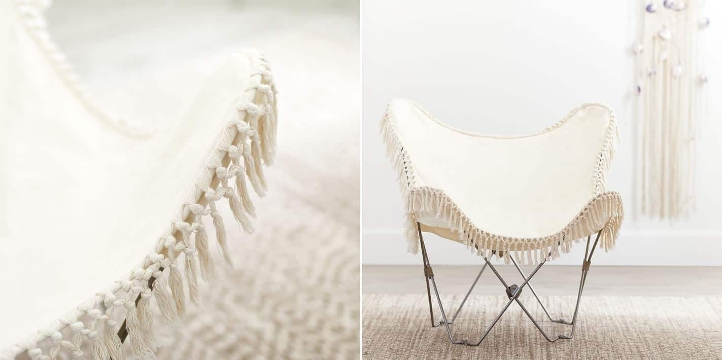 A CANVAS BUTTERFLY CHAIR WITH A FRINGE
