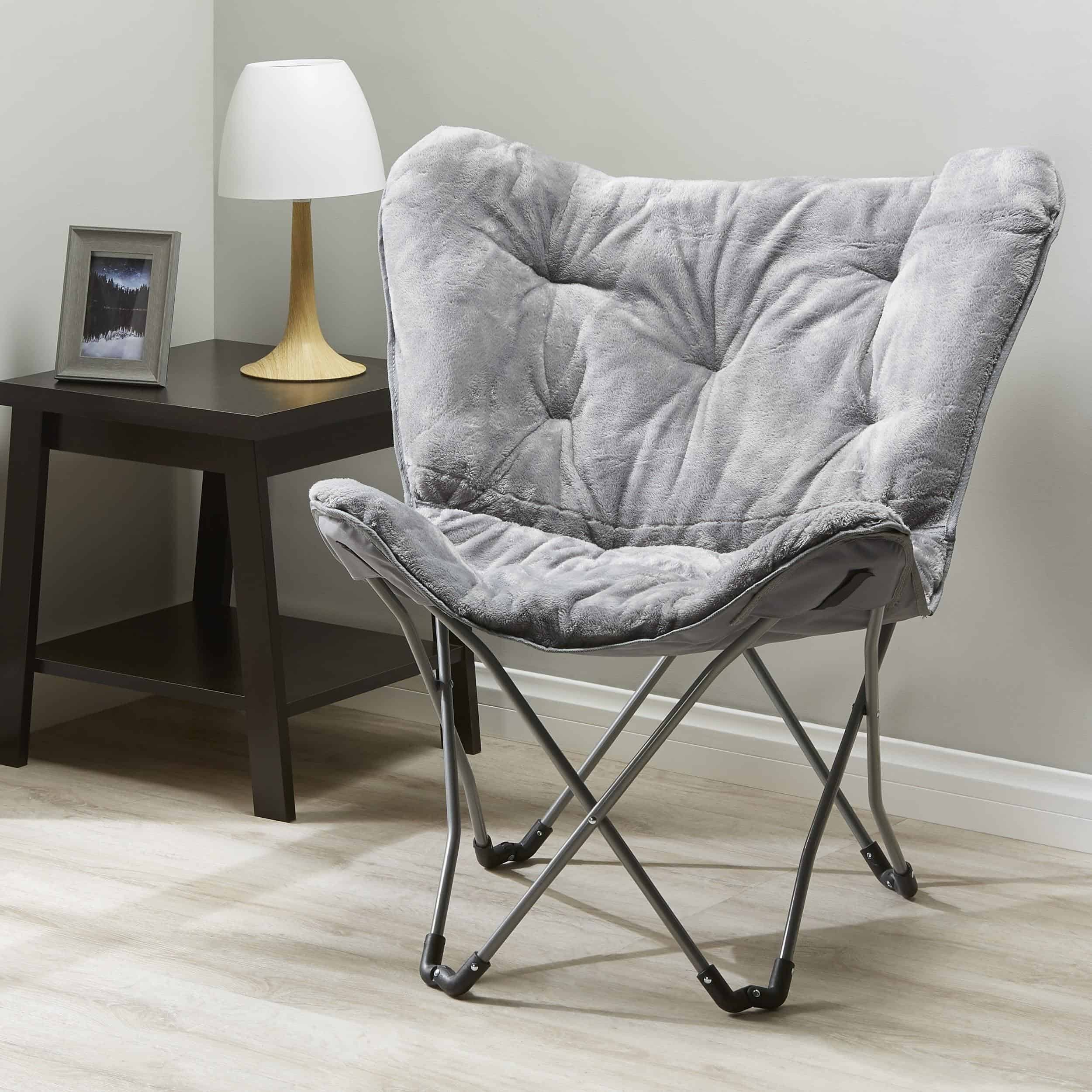 A COMFY CUSHIONED CHAIR WITH FAUX FUR