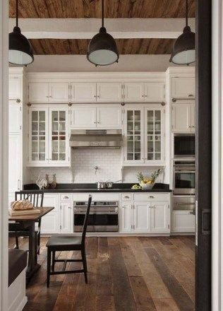 antique-white-kitchen-cabinets-with-dark-wood-floors-7188392