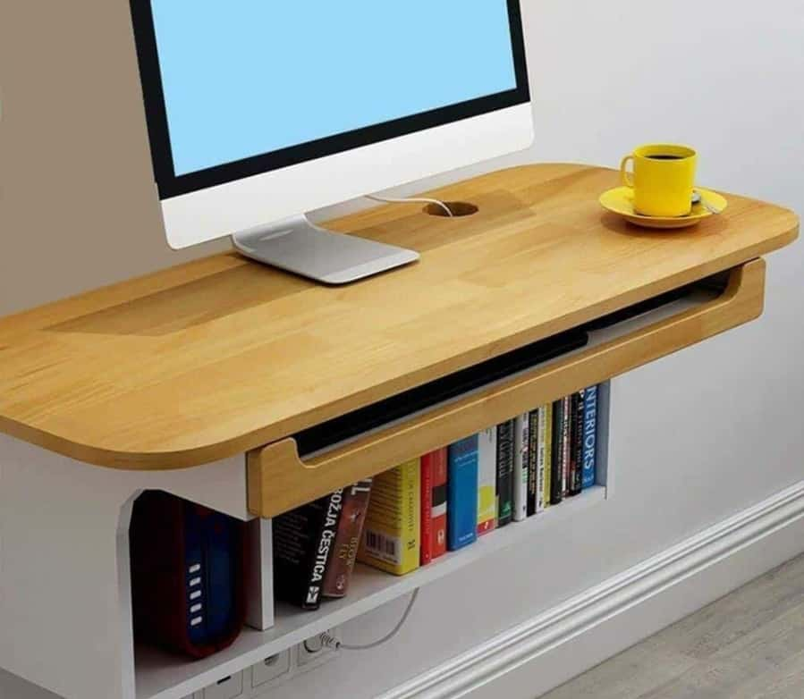 Dark themed bookcase attached floating desk